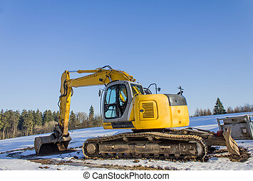 new excavator in the snow