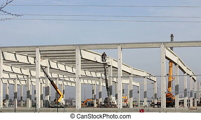 new factory construction site with workers