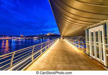 New Galata Bridge over Golden Horn with Istanbul night cityscape