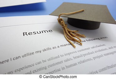 new grad - Job applicant resume and graduation cap...