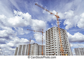 New high-rise building and construction cranes