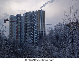 new high-rise buildings in a small town in winter
