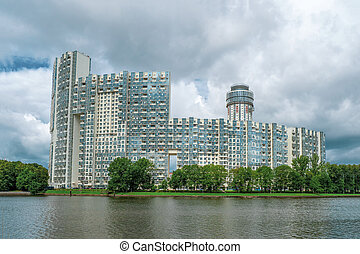 New high-rise buildings on a green hill. Khimki District, ...