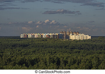 New high-rise buildings on a green hill. Moscow.