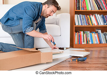 New home and man assembling furniture do it yourself