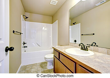 New home bathroom with shower and bath. - New home bathroom...