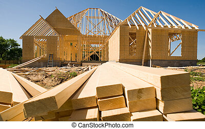 New Home Construction - A new home being built with wood, ...