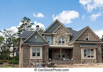 New Home Construction of Stone Brick and Siding - New brick ...