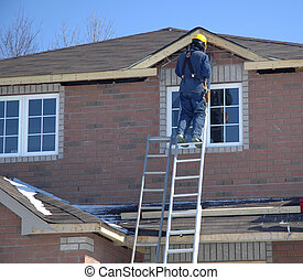New Home Construction - Tradesperson working on a new home.