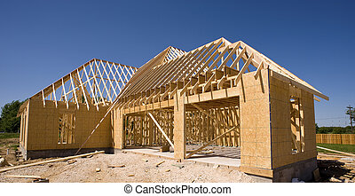 New Home Construction - A new home being built with wood,...