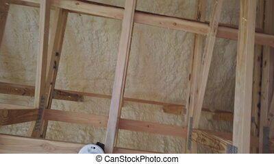 New home construction with installation of attic with foam insulation the roof