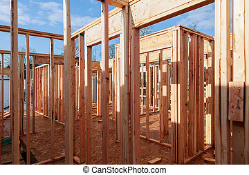 New home construction with wooden house frame