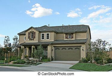 New Home Exterior - The exterior facade of a new model home...