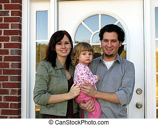 New Home family - Family at the front door of their new home