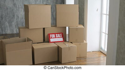 New home owners unpacking boxes. moving day concept. big...