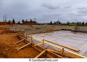 New homes in the process of being built with foundations foreground