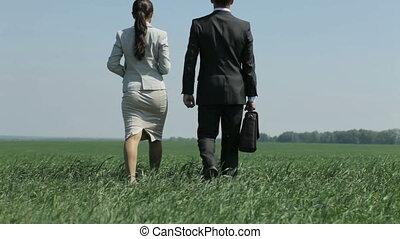 New horizon - Businessman and his loyal assistant walking...