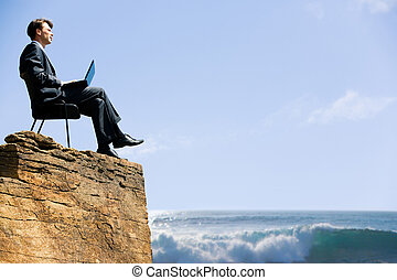New horizons - Image of confident business man sitting on ...