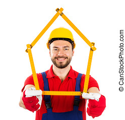 new house and improvement concept - construction worker with wooden ruler in hands