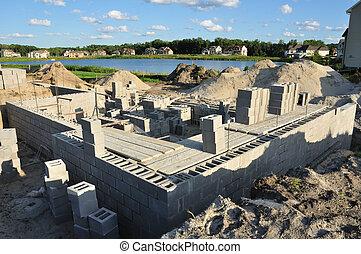New house construction, building foundation walls using concrete blocks