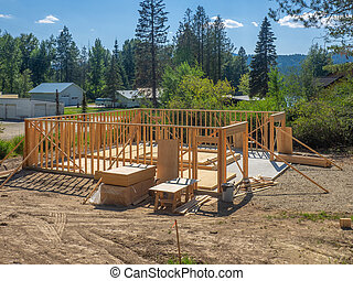 New house construction in the framing stages
