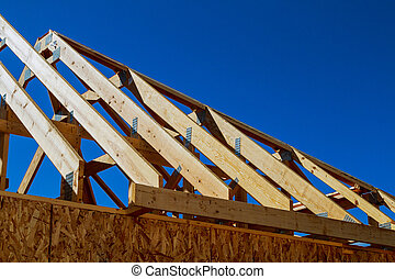 new house construction interior with exposed framing - The...