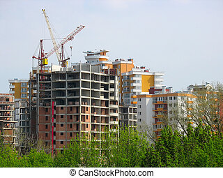New house construction view with cranes