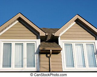 New house detail - Detail of a brand new house on a bright...