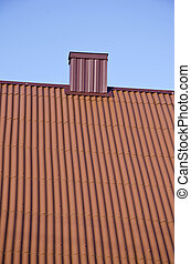 new house roof with metal chimney
