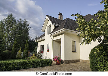 New house with a garden in a rural area