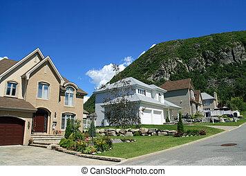New houses in a rich suburban neighborhood near the mountain...