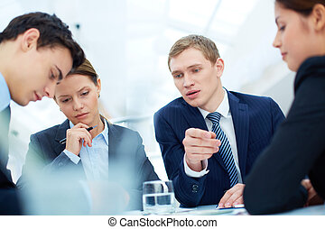 New ideas - Attentive business partners listening to new ...