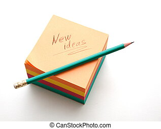 New ideas notes block and sharpened graphite pencil ready to...