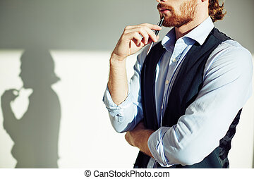 New ideas - Thoughtful businessman touching chin with pen