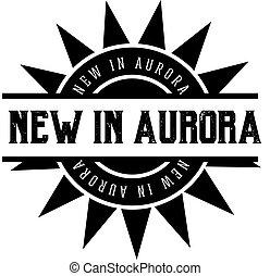 NEW IN AURORA black stamp on white