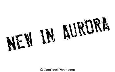 New In Aurora rubber stamp