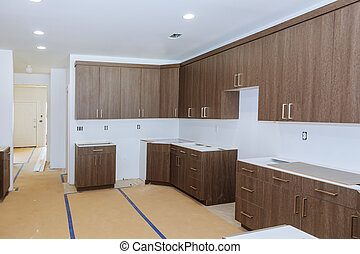 New installed wood kitchen cabinets with modern decorative stainless steel
