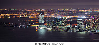 New Jersey panorama night view from New York City Manhattan with Hudson River and skyscrapers.