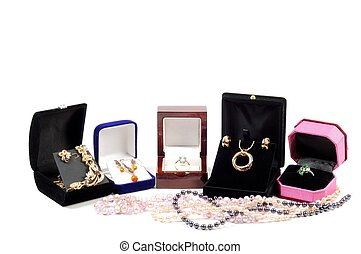 New jewelry in open boxes - An open jewlery boxes with gold...