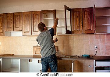 New kitchen cabinets - Carpenter working on new kitchen...