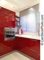 New kitchen in a modern home - Luxury kitchen with red and...
