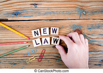New Law. Wooden letters on the office desk