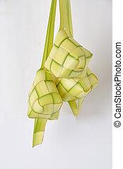 ketupat - new leaf woven ketupat on white background