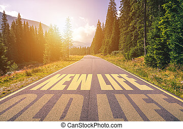 New life and old life concept. Driving on an empty road in the mountains to the New life and leaving behind the Old life.