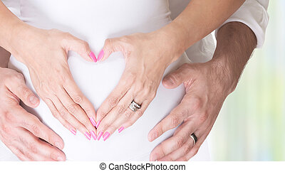 New life concept - Pregnant woman and her husband holding...
