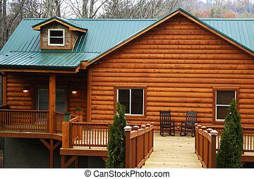 New log home with large wood deck.