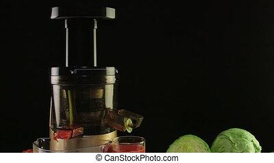 New masticating juicer machine making fresh vegetable tomato...