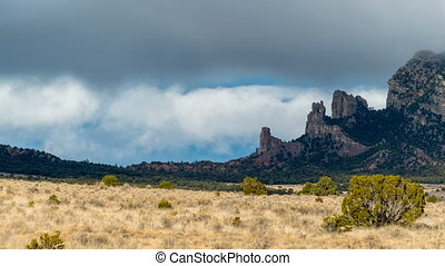 New Mexico Mountain Peaks - Storm clouds move quickly over...