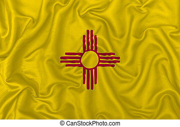 New Mexico state flag on a wavy silk satin fabric texture background.