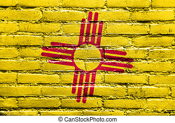 New Mexico State Flag painted on brick wall